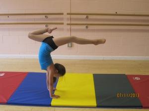 Audrey practicing her handstand stag!