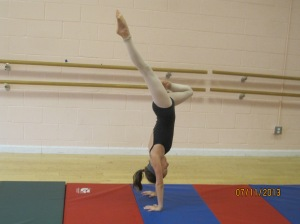 Hailey practicing her handstand passé!